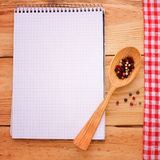 Pure notebook for recording menu, recipe on red ch Royalty Free Stock Photos