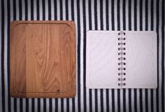 Pure notebook for recording menu, recipe on red checkered tablecloth tartan. Stock Photo