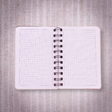 Pure notebook for recording menu, recipe on red checkered tablecloth tartan. Stock Photography
