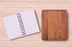 Pure notebook for recording menu, recipe on  tablecloth tartan. Stock Photo