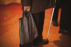 Pure old men holding bag Stock Images
