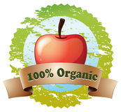 A pure organic label with a red apple Royalty Free Stock Photos