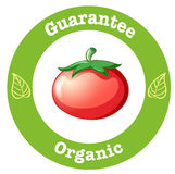 A pure organic label with a red tomato Stock Images