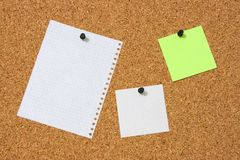 The pure pieces of paper. Enclosed to corkboard Stock Photo