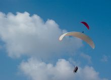 Pure pleasure. Three paragliders in the cloudy sky Royalty Free Stock Photo