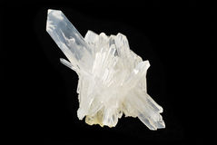 Pure Quartz Crystal on Black. A pure quartz crystal on black velvet.  This excellent mineral is used in crystal healing Stock Images