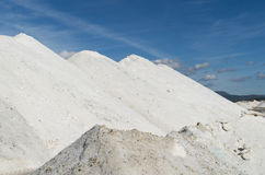 Pure  Sea salt mountain in a saline in Sardinia and blu sky. Mountains of sea salt in a saline , sardinia and blue sky and clouds Stock Photography