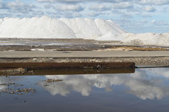 Pure  Sea salt mountain in a saline in Sardinia and blu sky. Mountains of sea salt in a saline , sardinia and blue sky and clouds Stock Images
