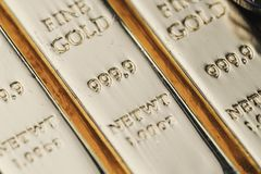 Pure 999.9 shiny fine gold bullions ingot bars, closed up macro. Shot as financial asset, investment and wealth concept stock photos
