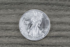 Pure Silver Dollar on Faded Wood Royalty Free Stock Photo