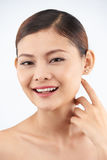 Pure skin. Attractive Asian woman with pure skin smiilng at camera Royalty Free Stock Image