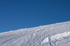 Pure Slope. Ski slope at its purest -- clear sky, white snow, traces of wintersport visible Royalty Free Stock Photography