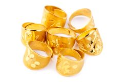 Pure solid gold rings on white background stock photography