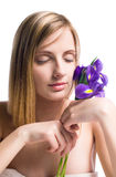 Pure spa beauty with iris flower. Royalty Free Stock Images