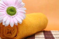 Pure spa health. The image of bright faintly yellow towel, lilly and tones to make impression of pure and simple natural beauty and components of processing of a Stock Image