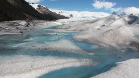 Pure transparent blue water in snowy mountains and glacier in Antarctica. stock video footage