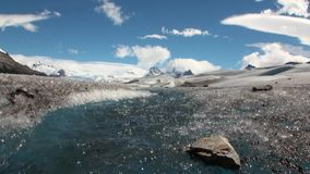 Pure transparent water of creek in snowy mountains and glacier in Antarctica. stock video footage