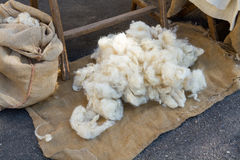 Pure virgin wool hand working with traditional methods. Ancient crafts historic medieval festival Stock Photography
