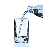 Pure water. Glass and bottle with pure water over white stock photography