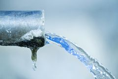 Pure water. An image of a fountain pouring fresh water close up Royalty Free Stock Image