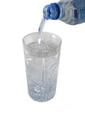 Pure water. Watering pouring into a glass Royalty Free Stock Images