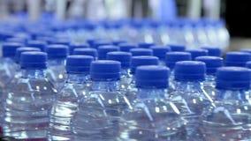 Pure water bottle conveyor stock footage