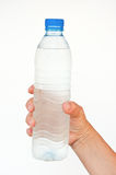 Pure water bottle in hand Royalty Free Stock Image