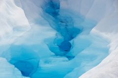 Pure water in crest of glacier in Chile royalty free stock images