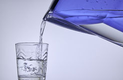Pure water from filter pouring in a glass Stock Photography