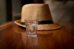 Pure water on glass with vintage hat. On table Stock Photo