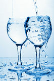 Pure water pouring into glasses Royalty Free Stock Photo