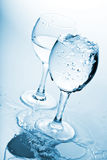 Pure water splashing into glasses Stock Photo