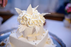 Pure white cake with creamy flowers Royalty Free Stock Photo