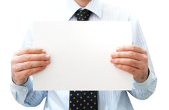 Pure white card in man's hands royalty free stock photography