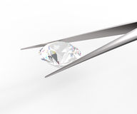 Pure white diamond in tweezers. 3D rendere. Pure white diamond in tweezers on a white background. 3d digitally rendered illustration Stock Photos