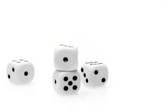Pure white dice on white table with space for text Royalty Free Stock Photos