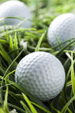 Pure White Golfball on green grass Stock Photography