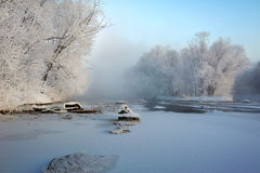 The pure white rime and blue sky and frozen river sunrise Royalty Free Stock Image