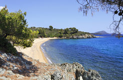 Pure white sand beach in the bay of the Aegean Sea. Royalty Free Stock Photos