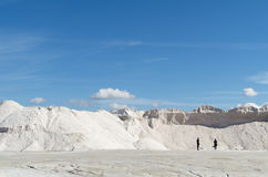 Pure white Sea salt mountain. Mountains of sea salt in a saline , sardinia and blue sky and clouds Stock Photography
