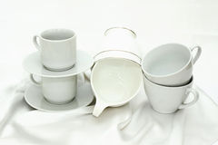Pure white utensils on a white cloth Stock Image