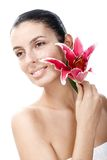 Pure young female face with lily Stock Photos