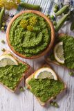 Puree of fresh peas and sandwiches close-up. vertical top view Royalty Free Stock Photography