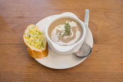Puree mushroom soup in white bowl with garlic bread Royalty Free Stock Photos