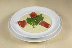 Puree soup with ham and greens Stock Photos