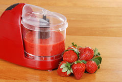 Pureed strawberries in blender royalty free stock image