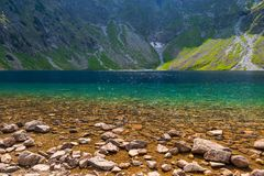The purest mountain lake Czarny Staw on a sunny day. In the Tatras, Poland royalty free stock photos