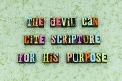 Pureza del propósito de la religión de la escritura del diablo foto de archivo
