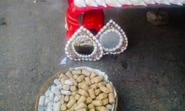 Sandalwood powder stick. Puri, Odisha - sandalwood powder sticks and beautifully designed mirrors selling at local market Royalty Free Stock Image