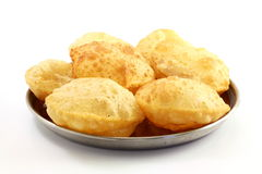 Puri or Poori traditional indian homemade deep fried bread or chapati Royalty Free Stock Photo
